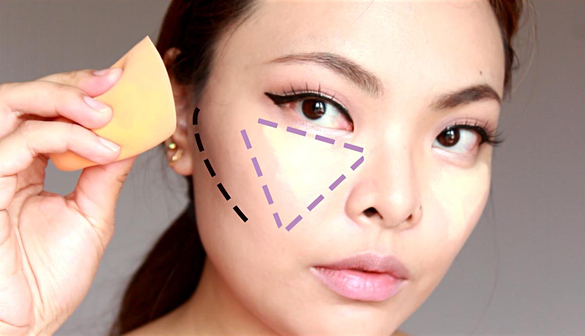 Mẹo dùng kem che khuyết điểm vùng mắt là đánh khối tam giác và dùng mút tán đều